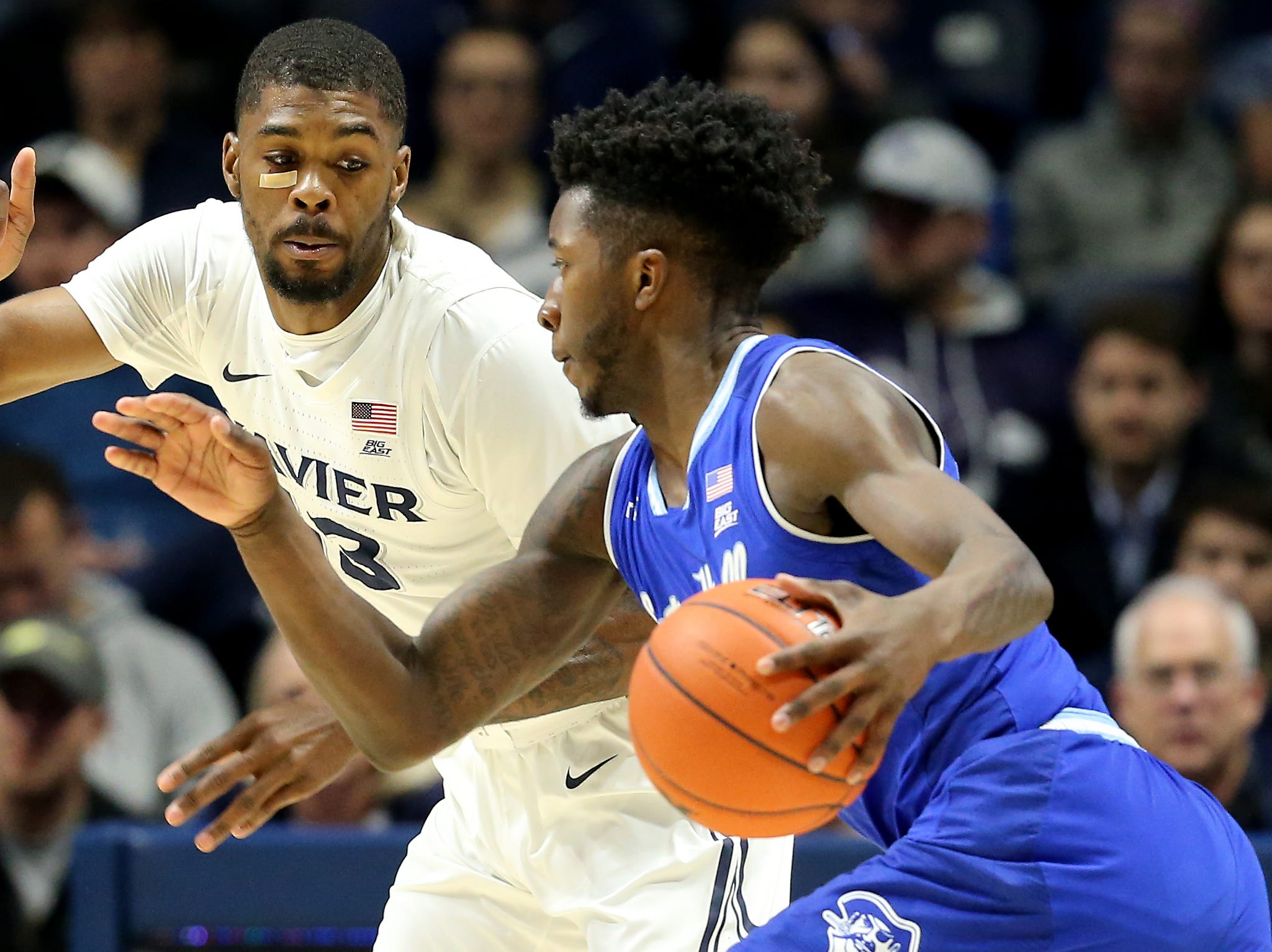 Xavier Musketeers forward Naji Marshall (13) defends in the first half of an NCAA college basketball game against the Seton Hall Pirates, Wednesday, Jan. 2, 2019, at the Cintas Center in Cincinnati.
