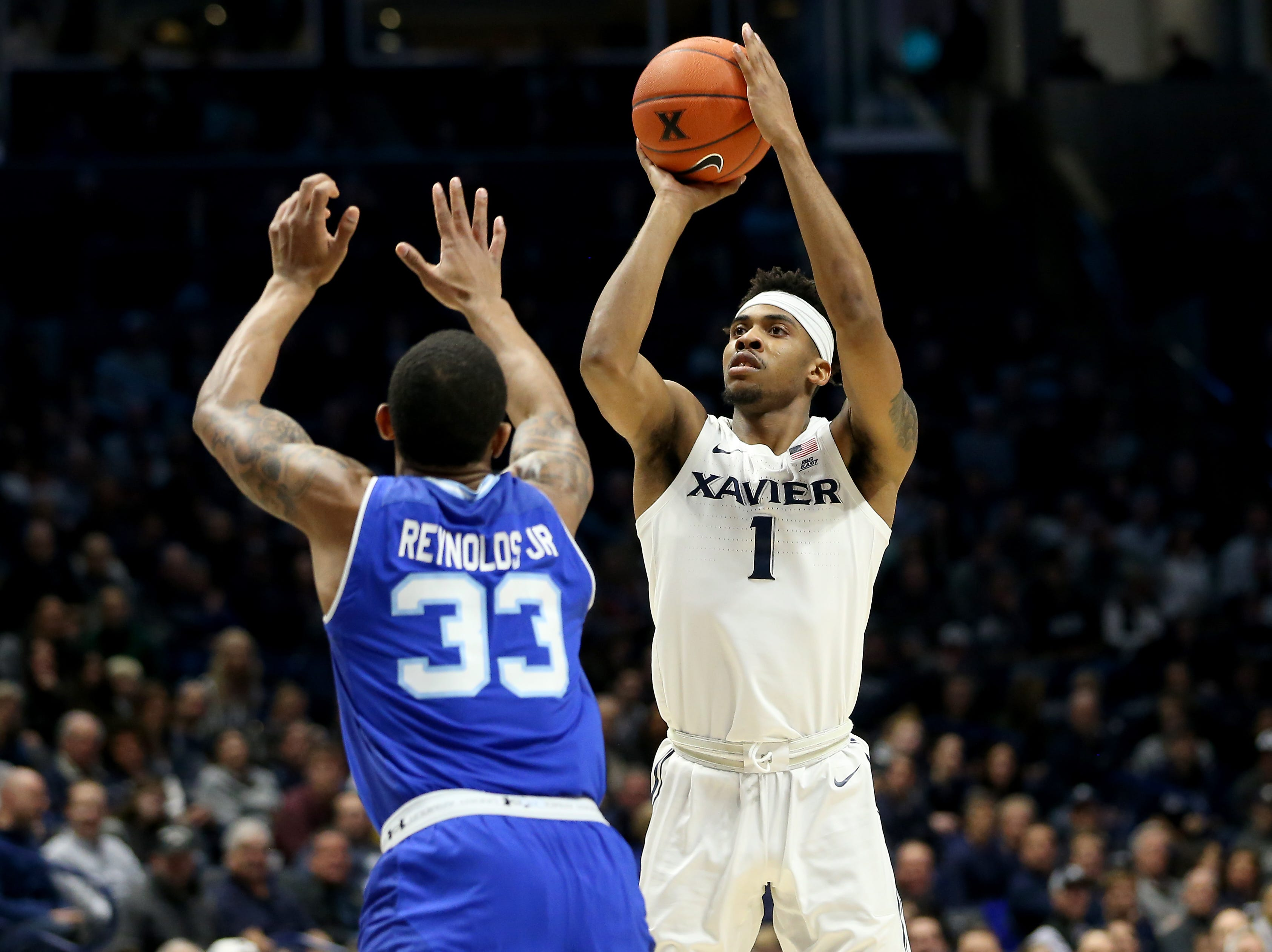 Xavier Musketeers guard Paul Scruggs (1) rises for a shot over Seton Hall Pirates guard Shavar Reynolds (33) in the first half of an NCAA college basketball game, Wednesday, Jan. 2, 2019, at the Cintas Center in Cincinnati.