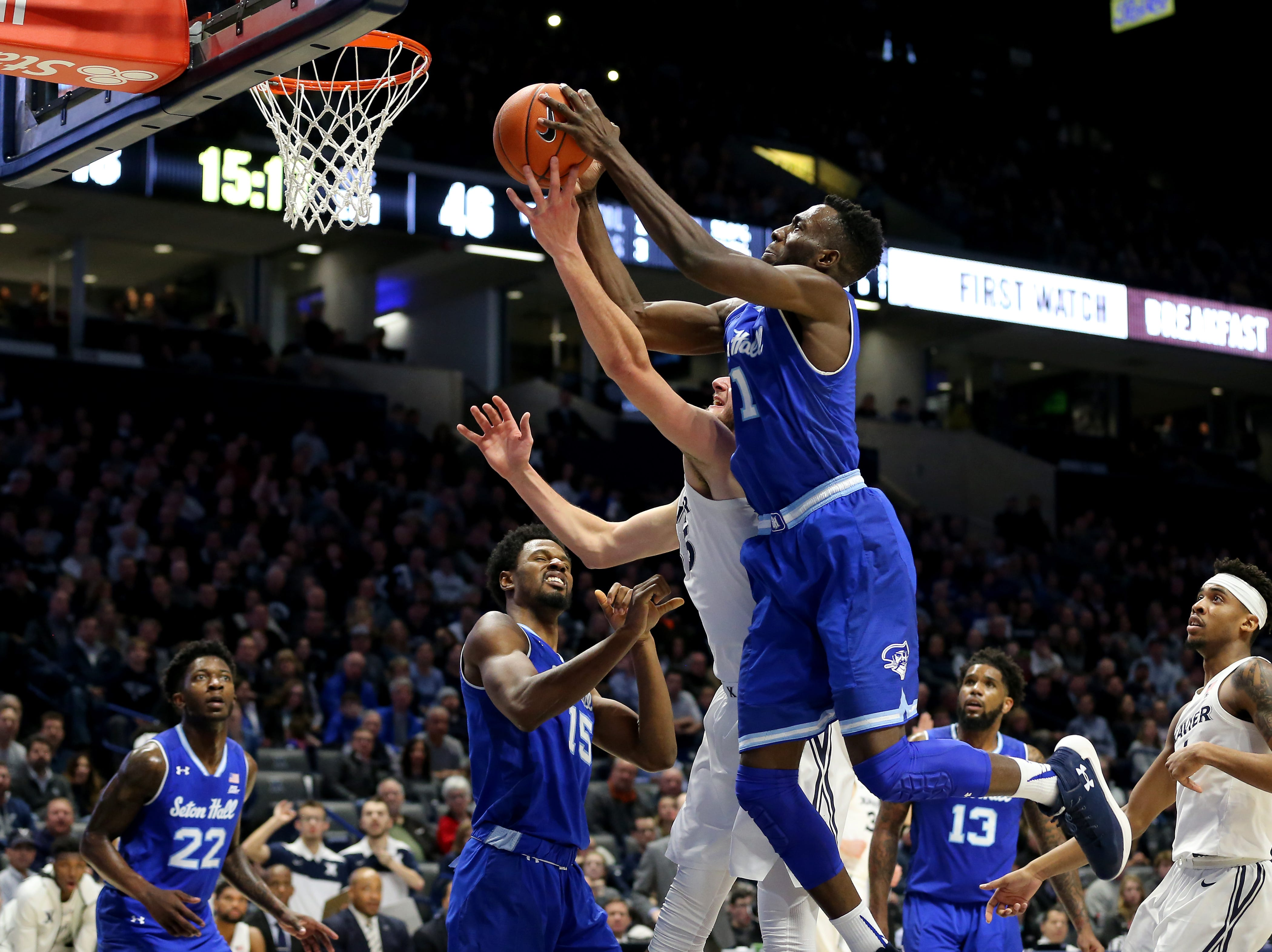 Seton Hall Pirates forward Michael Nzei (1) pulls down a rebound over Xavier Musketeers forward Zach Hankins (35) in the second half of an NCAA college basketball game, Wednesday, Jan. 2, 2019, at the Cintas Center in Cincinnati. Seton Hall won 80-70.