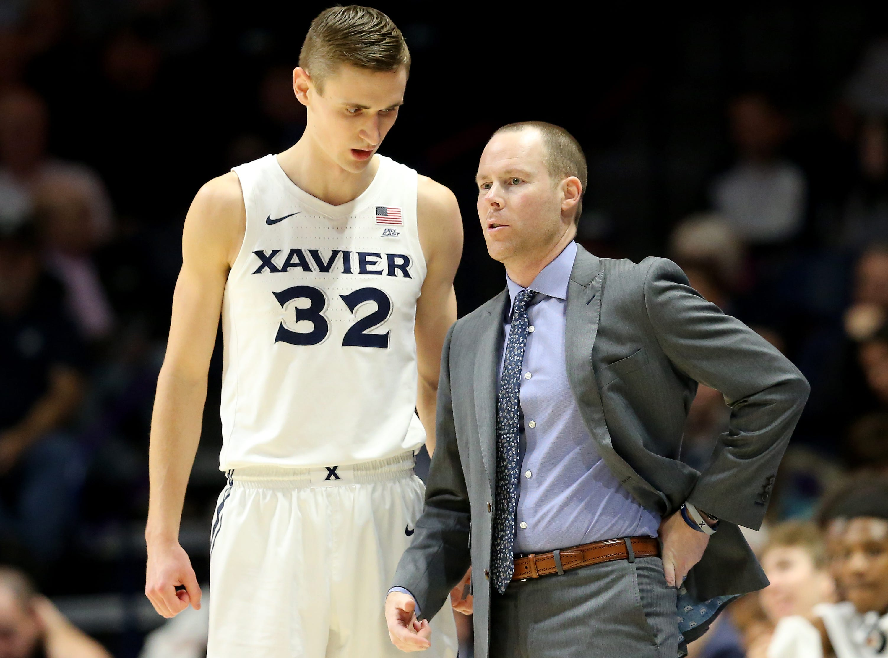 Xavier Musketeers head coach Travis Steele talks with Xavier Musketeers forward Ryan Welage (32) in the first half of an NCAA college basketball game, Wednesday, Jan. 2, 2019, at the Cintas Center in Cincinnati.