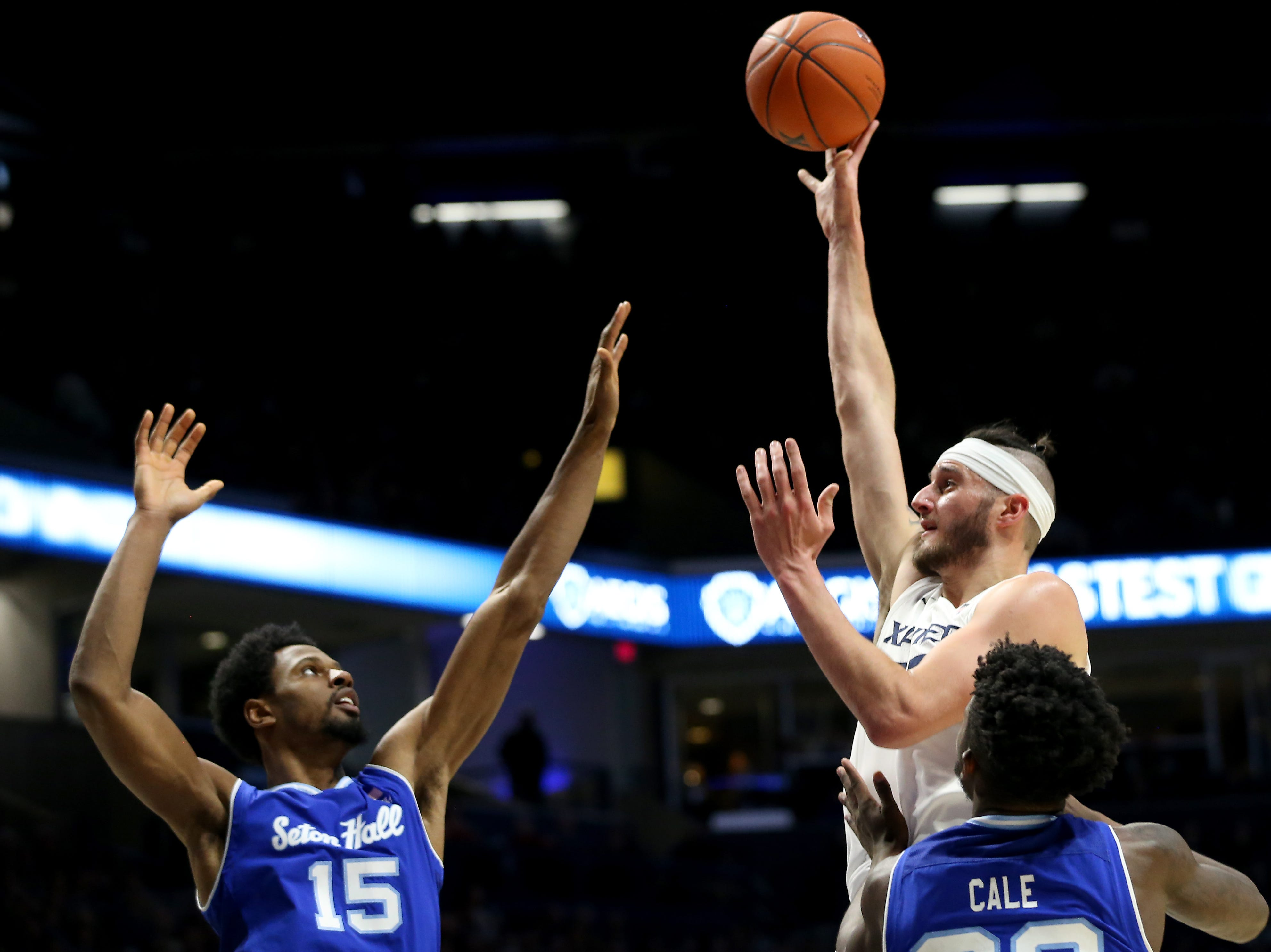 Xavier Musketeers forward Zach Hankins (35) goes up for a shot as Seton Hall Pirates forward Taurean Thompson (15) defends in the first half of an NCAA college basketball game, Wednesday, Jan. 2, 2019, at the Cintas Center in Cincinnati.