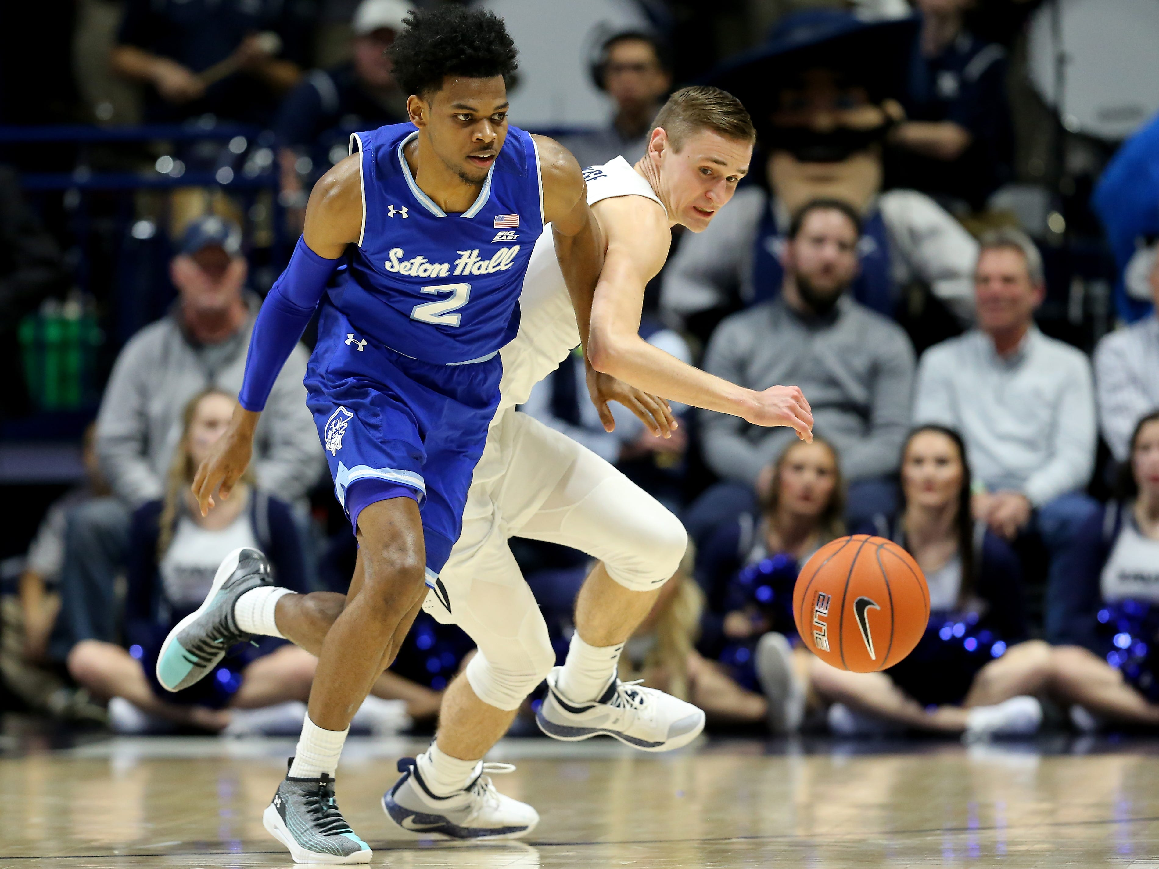 Xavier Musketeers forward Ryan Welage (32) and Seton Hall Pirates guard Anthony Nelson (2) chase a loose ball in the second half of an NCAA college basketball game, Wednesday, Jan. 2, 2019, at the Cintas Center in Cincinnati. Seton Hall won 80-70.