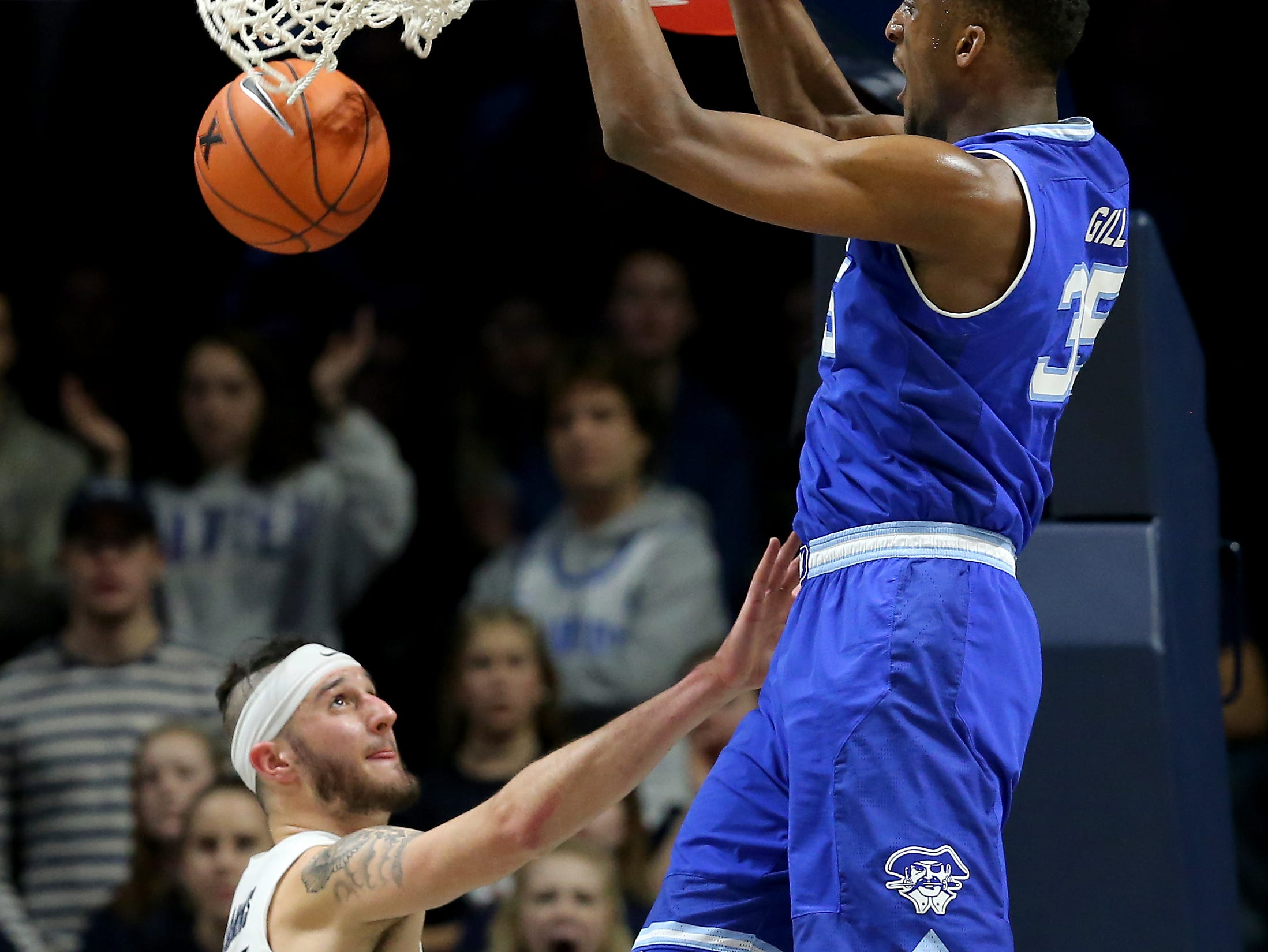 Seton Hall Pirates center Romaro Gill (35) dunks over Xavier Musketeers forward Zach Hankins (35) in the second half of an NCAA college basketball game, Wednesday, Jan. 2, 2019, at the Cintas Center in Cincinnati. Seton Hall won 80-70.