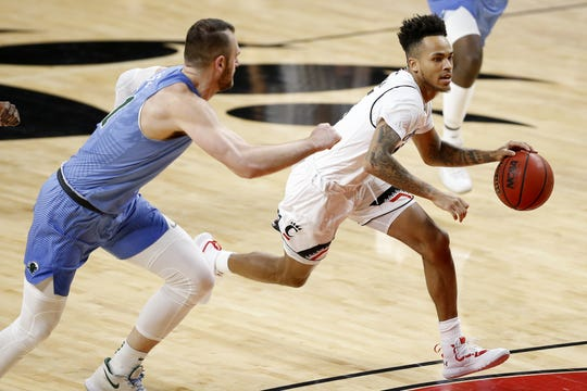 Cincinnati Bearcats guard Cane Broome (15) drives down court in the first half of the NCAA American Athletic Conference basketball game between the Cincinnati Bearcats and the Tulane Green Wave at Fifth Third Arena in Cincinnati on Wednesday, Jan. 2, 2019.