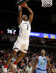 Cincinnati Bearcats guard Keith Williams (2) leaps to the basket in the second half of the NCAA American Athletic Conference basketball game between the Cincinnati Bearcats and the Tulane Green Wave at Fifth Third Arena in Cincinnati on Wednesday, Jan. 2, 2019. The Bearcats opened conference play with a 93-61 win over Tulane.