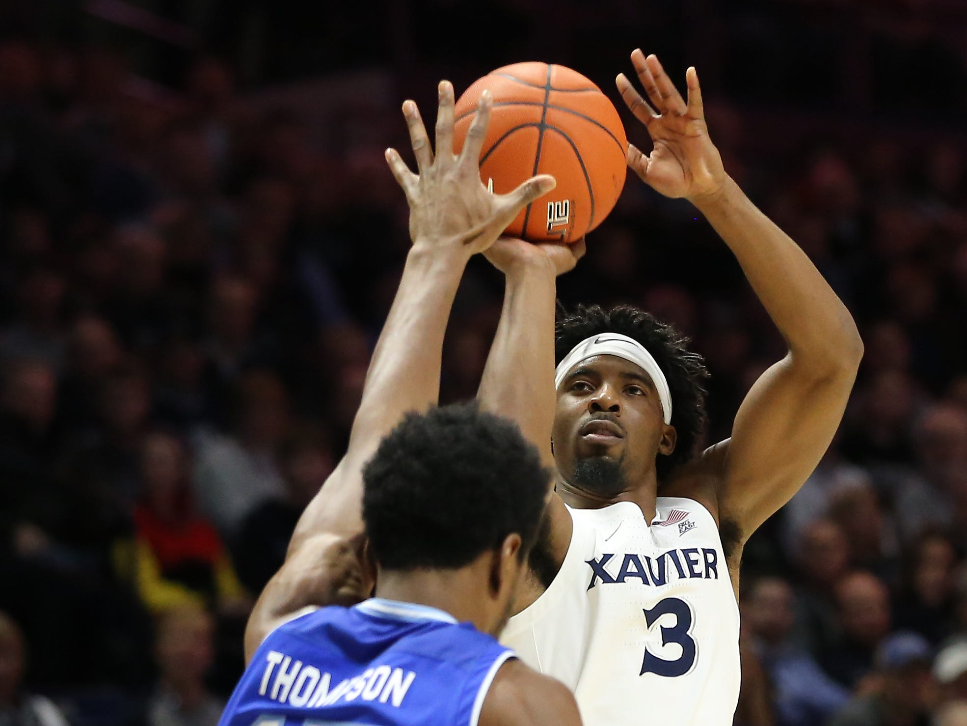 Xavier Musketeers guard Quentin Goodin (3) rises for a shot over Seton Hall Pirates forward Taurean Thompson (15) in the first half of an NCAA college basketball game, Wednesday, Jan. 2, 2019, at the Cintas Center in Cincinnati.