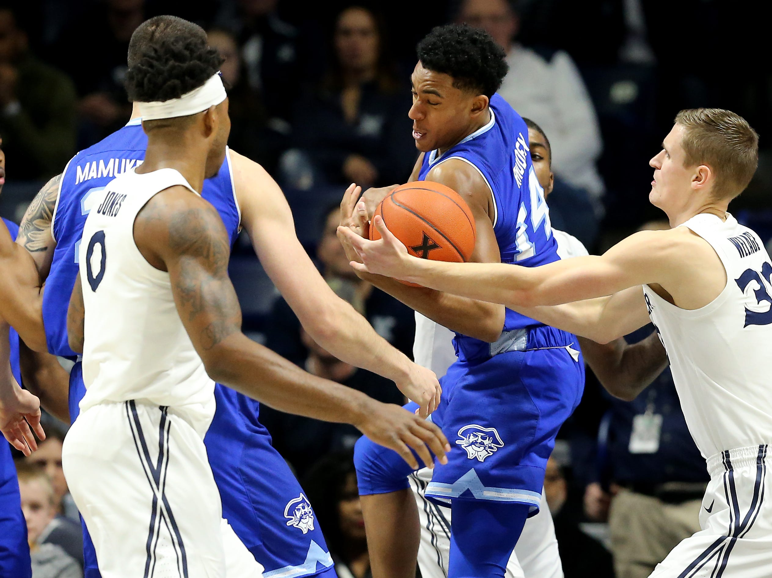 Seton Hall Pirates guard Jared Rhoden (14) pulls down a rebound away from Xavier Musketeers forward Ryan Welage (32) in the first half of an NCAA college basketball game, Wednesday, Jan. 2, 2019, at the Cintas Center in Cincinnati.