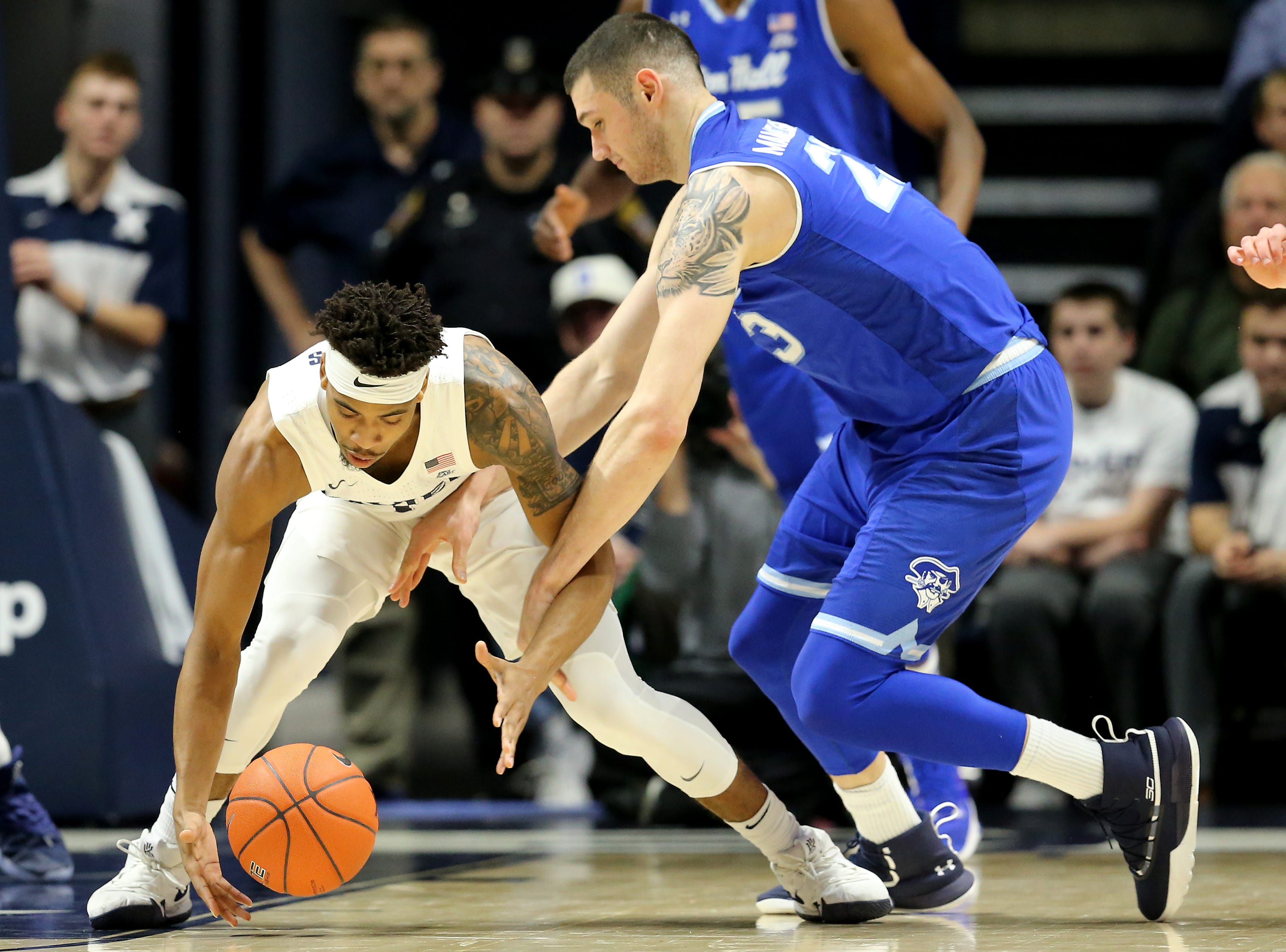 Xavier Musketeers guard Paul Scruggs (1) picks up a loose ball in the first half of an NCAA college basketball game against the Seton Hall Pirates, Wednesday, Jan. 2, 2019, at the Cintas Center in Cincinnati.