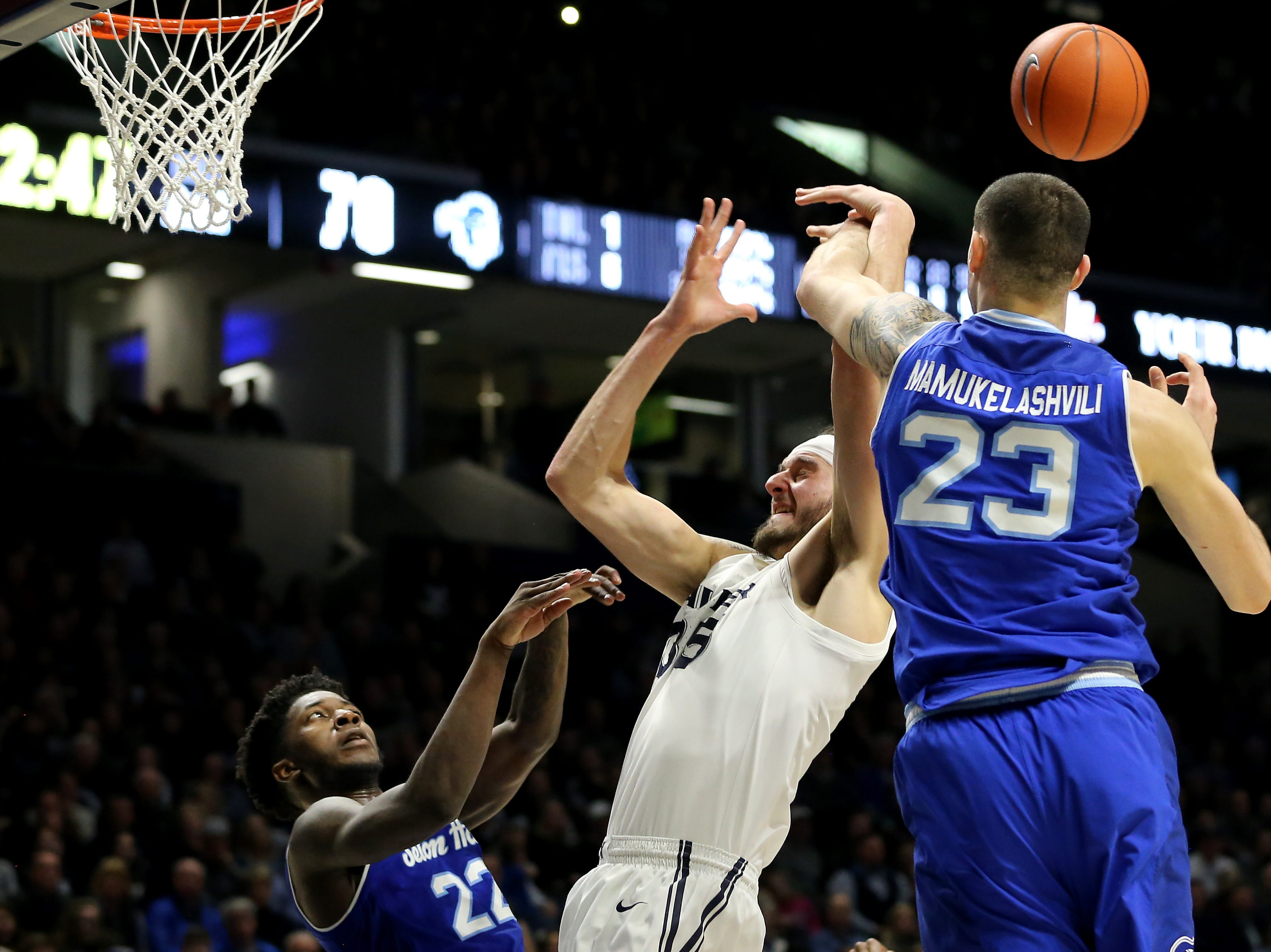 Seton Hall Pirates forward Sandro Mamukelashvili (23) strips the ball from Xavier Musketeers forward Zach Hankins (35) in the second half of an NCAA college basketball game, Wednesday, Jan. 2, 2019, at the Cintas Center in Cincinnati. Seton Hall won 80-70.