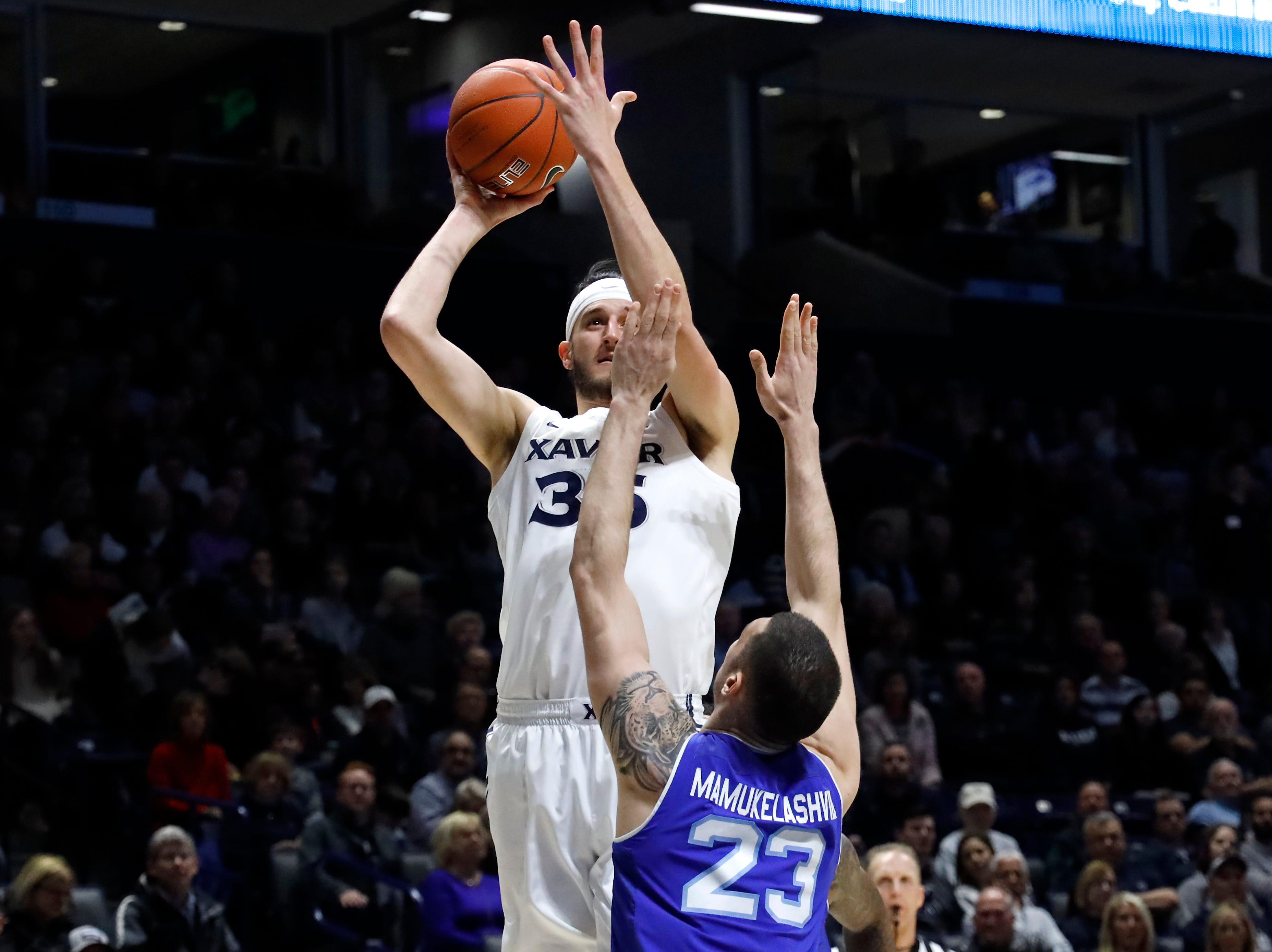 Xavier Musketeers forward Zach Hankins (35) rises for a shot over Seton Hall Pirates forward Sandro Mamukelashvili (23) in the first half of an NCAA college basketball game, Wednesday, Jan. 2, 2019, at the Cintas Center in Cincinnati.