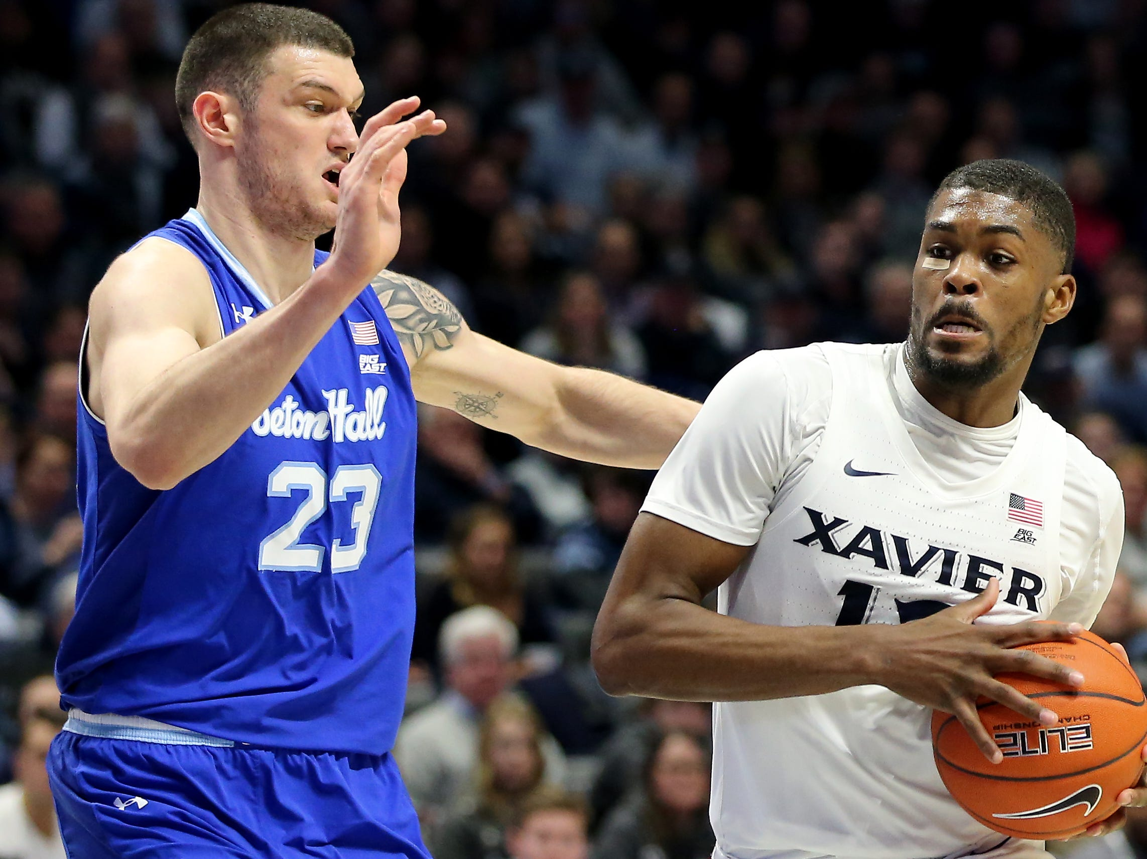 Xavier Musketeers forward Naji Marshall (13) drives to the basket as Seton Hall Pirates forward Sandro Mamukelashvili (23) defends in the second half of an NCAA college basketball game, Wednesday, Jan. 2, 2019, at the Cintas Center in Cincinnati. Seton Hall won 80-70.