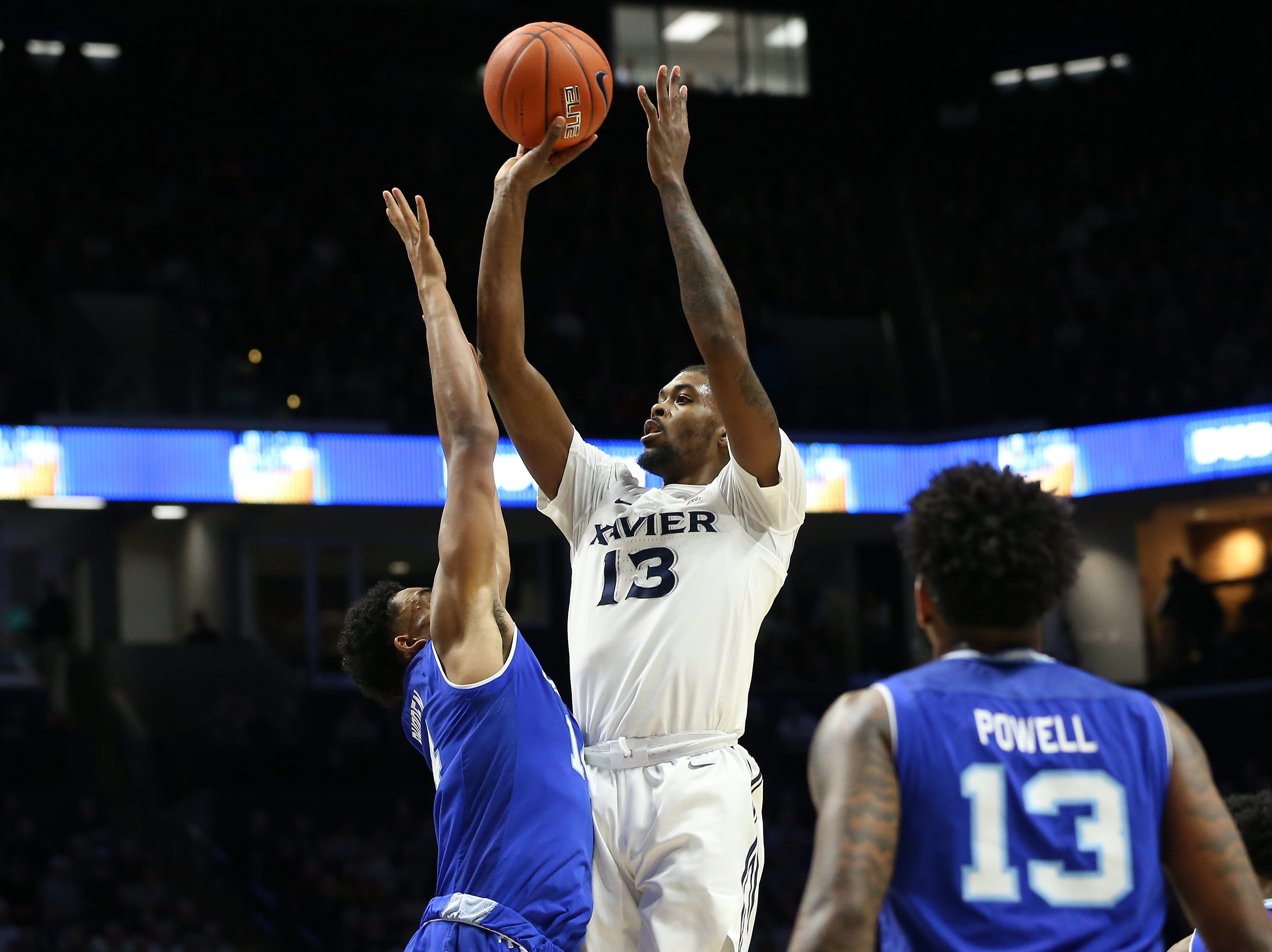 Xavier Musketeers forward Naji Marshall (13) rises for a shot in the first half of an NCAA college basketball game against the Seton Hall Pirates, Wednesday, Jan. 2, 2019, at the Cintas Center in Cincinnati.