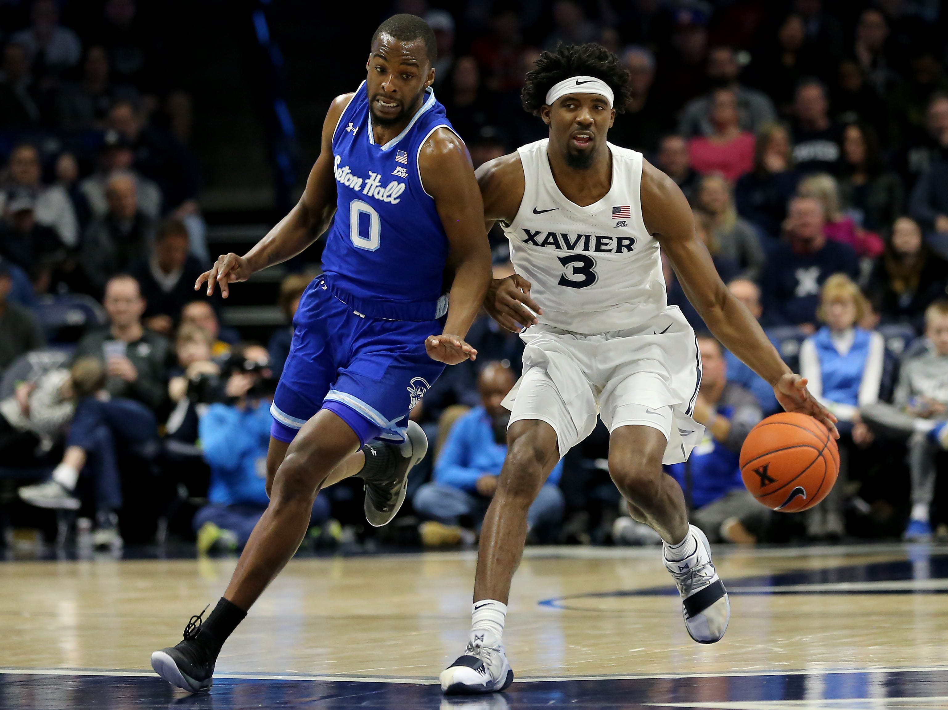 Xavier Musketeers guard Quentin Goodin (3) brings the ball up the court as Seton Hall Pirates guard Quincy McKnight (0) defends in the first half of an NCAA college basketball game, Wednesday, Jan. 2, 2019, at the Cintas Center in Cincinnati.