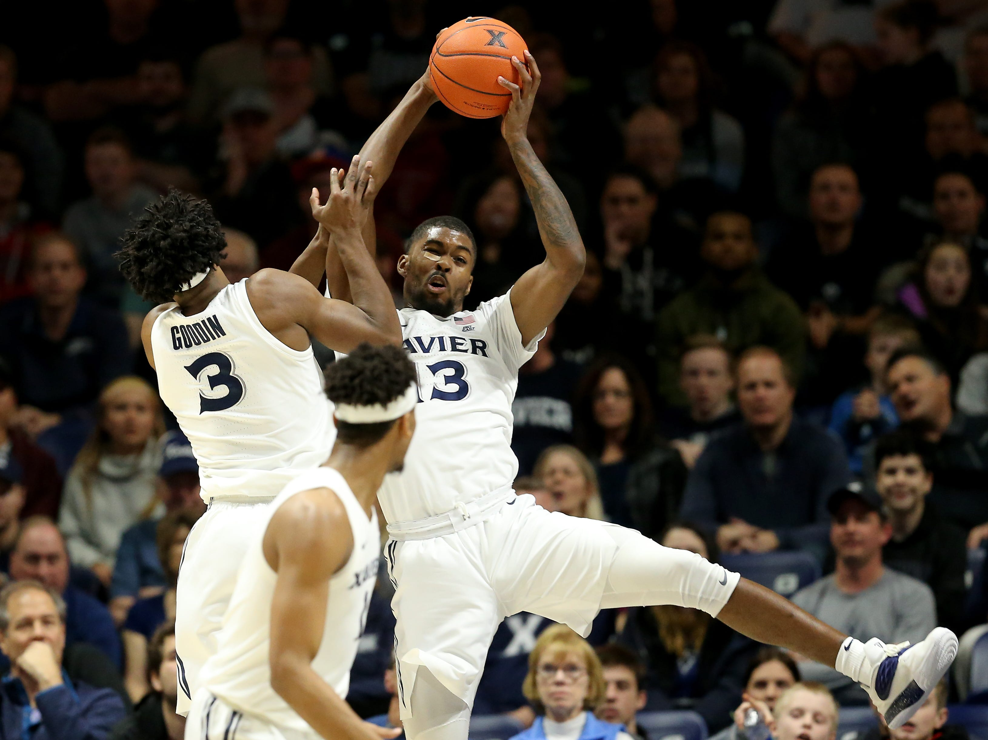 Xavier Musketeers forward Naji Marshall (13) pulls down a rebound in the first half of an NCAA college basketball game against the Seton Hall Pirates, Wednesday, Jan. 2, 2019, at the Cintas Center in Cincinnati.