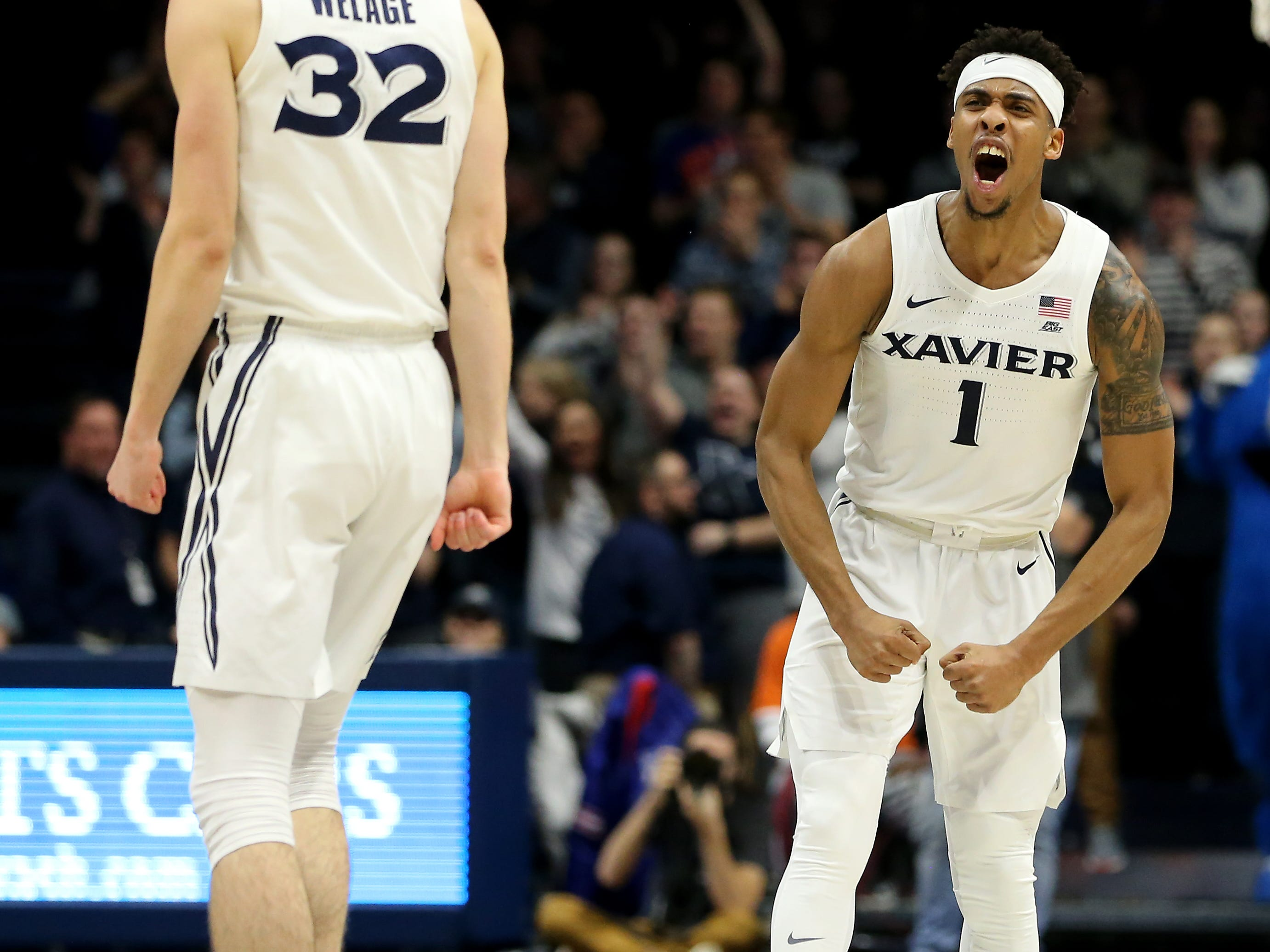 Xavier Musketeers guard Paul Scruggs (1) celebrates with Xavier Musketeers forward Ryan Welage (32) after scoring a 3-point basket in the second half of an NCAA college basketball game against the Seton Hall Pirates, Wednesday, Jan. 2, 2019, at the Cintas Center in Cincinnati. Seton Hall won 80-70.