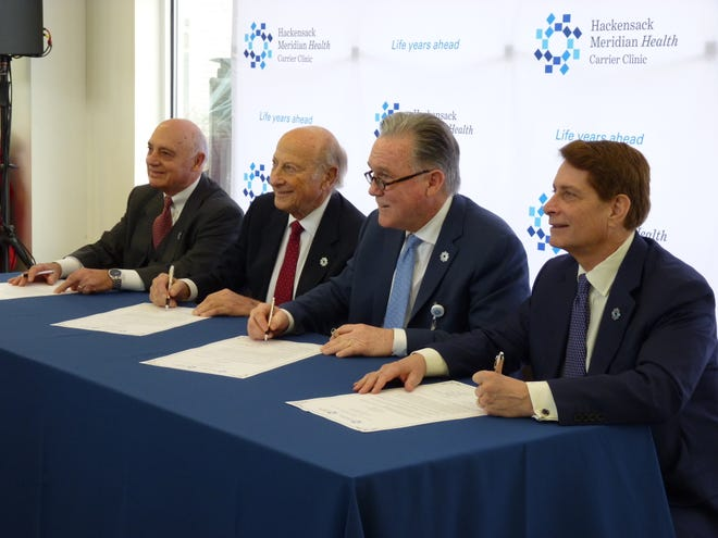 From left: Carrier Clinic Board of Trustees Chair Tom Amato, Hackensack Meridian Health Board of Trustees Chair Gordon Litwin, Carrier Clinic President & CEO Donald Parker, Hackensack Meridian Health CEO Robert Garrett signing the merger agreement on Jan. 3, 2019.