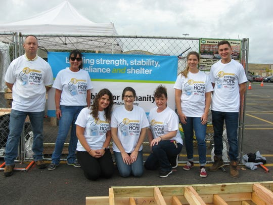 "At a recent ""Coming Home with Habitat"" event, a volunteer group from K. Hovnanian Homes joined Habitat for Humanity of Greater Plainfield and Middlesex County, Magic 98.3 FM, 1450 AM WCTC, and other sponsors and volunteers."