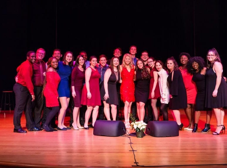 Tony Award-winner Kelli O'Hara poses on stage with Kean University music and theatre students who sang backup on two songs in her Kean Stage concert.