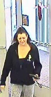 Police are looking to identify this woman in connection with the theft of a VFW collection jar containing about $500.