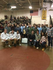 Watchung Hills wrestling alumni members pose before the Warriors win over Delaware Valley on Jan. 2, 2019.