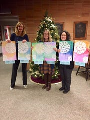 Pictured here with some of the artwork are Alisa Swider, Whitehouse School third grade teacher, Kathleen Seelig, Hunterdon Medical Center 's Corporate Director of Public Relations & Marketing, & Dana Pierro, Whitehouse School art teacher.