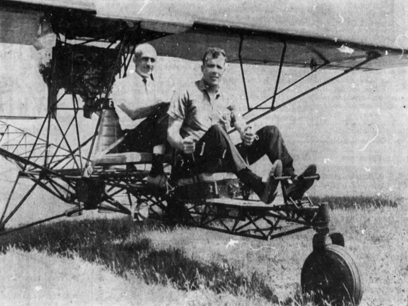 "Robert Dahl, left, and Mark Mosier show off their home-built flying machine. Swift, owner and operator of the Willows Supper Club near Washington, Iowa, and Dahl, manager of the local Fareway Store built the ""Breezy"" aircraft with help from Richard Embree, owner and operator of Norton Plumbing, Heating and Cooling. It cost about $3,000 and took them about 9 months to build."