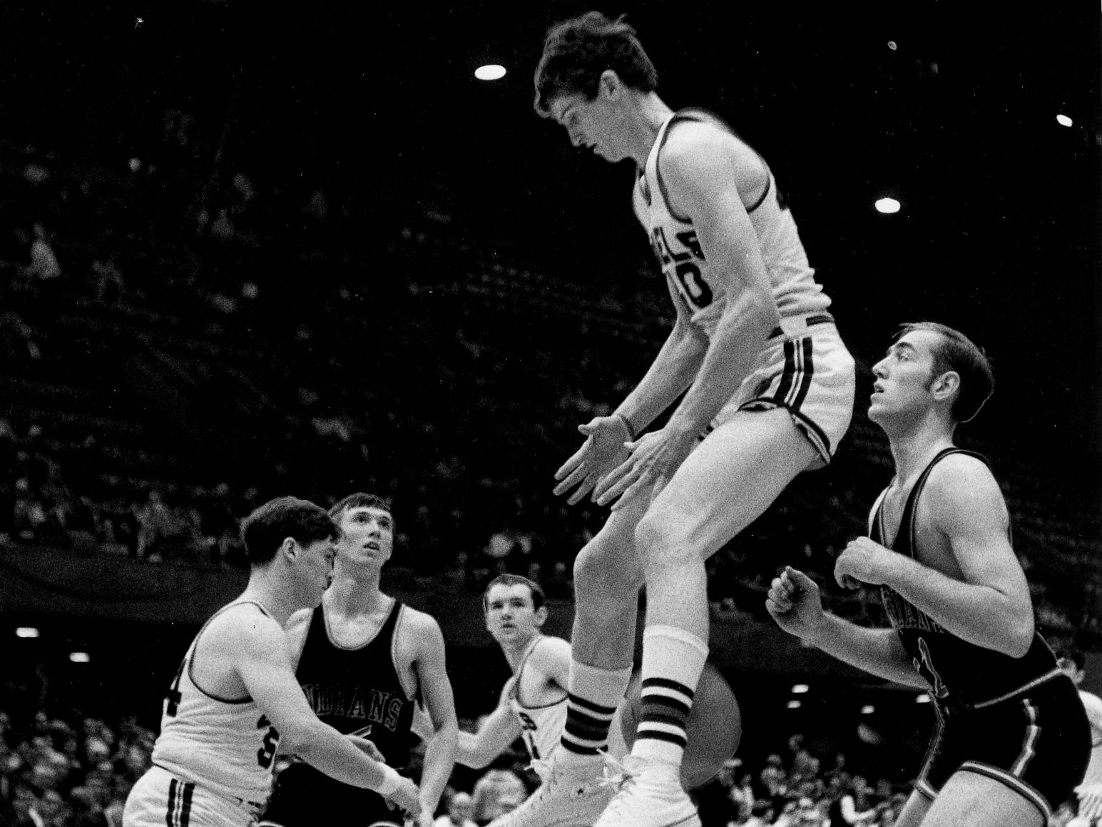 The year is 1969. Tim Deiters, Walsh of Ottumwa's flashy center, stays one jump ahead of the opposition in a semifinal round victory over Cedar Valley of Somers. Deiter scored 32 points.