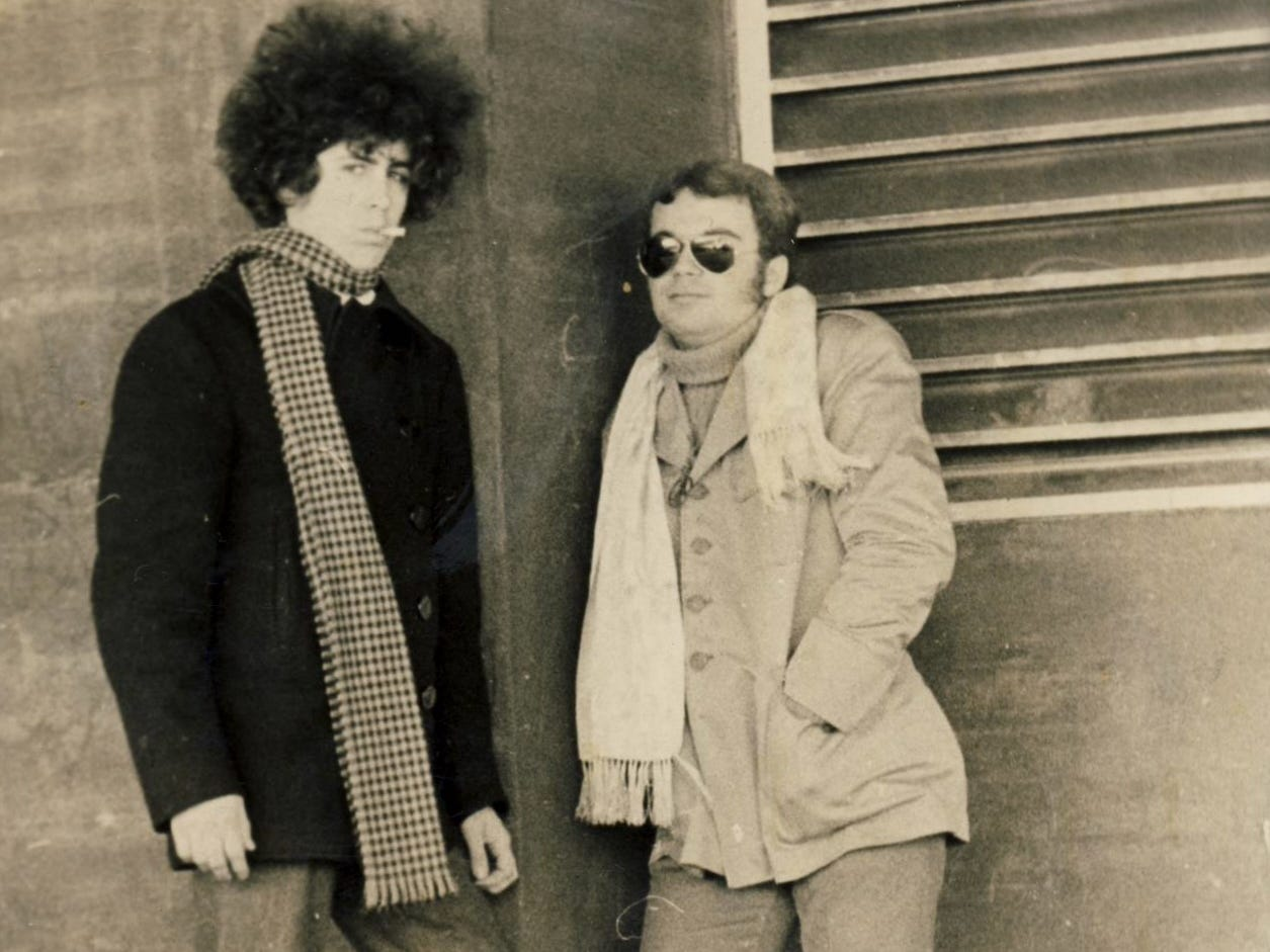 Patrick Bauer, left, now a professor at the University of Iowa College of Law, back in this 1969 photo at Wesleyan University in Connecticut was attempting to look like Bob Dylan as much as possible. He's standing next to a friend from his dorm floor, Michael Kaloyanides, now a professor of ethnomusicology at the University of New Haven. Bauer has spent his life enthralled by Dylan.