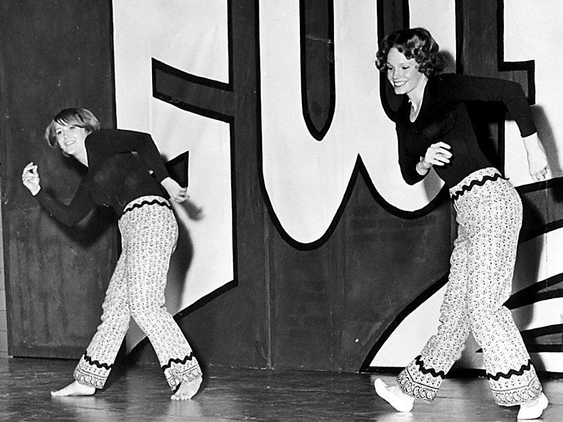 Grinnell High School students Kathy Haner, left, and Cheryl George present a dance a dance number at the Grinnell High Variety Show, a benefit for a school band, on Feb. 16, 1969.