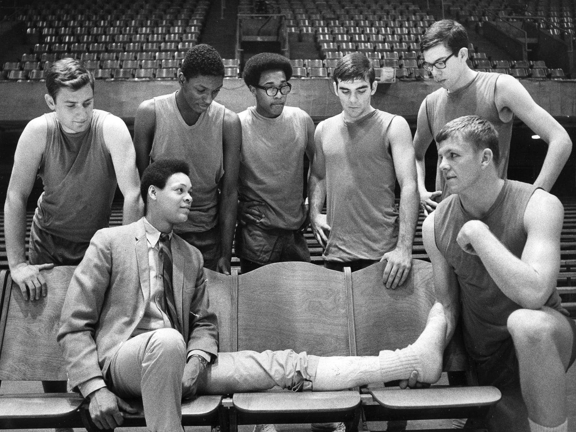 The year is 1969. Cedar Rapids players gather around their No. 2 scorer, Rick Williams, who suffered a broken foot in the districk tournament final.