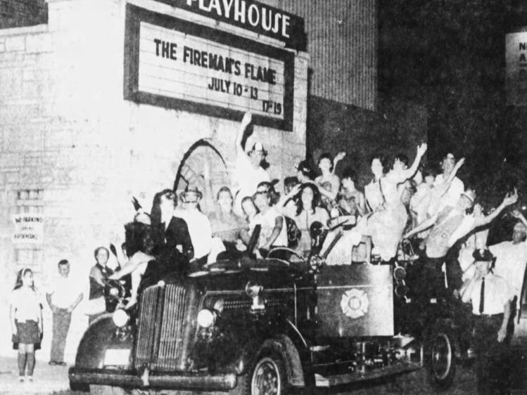 "The cast of ""The Fireman's Flame,"" which was playing at the Des Moines Playhouse, sings its final number for a firetruck borrowed from the Des Moines Fire Department."