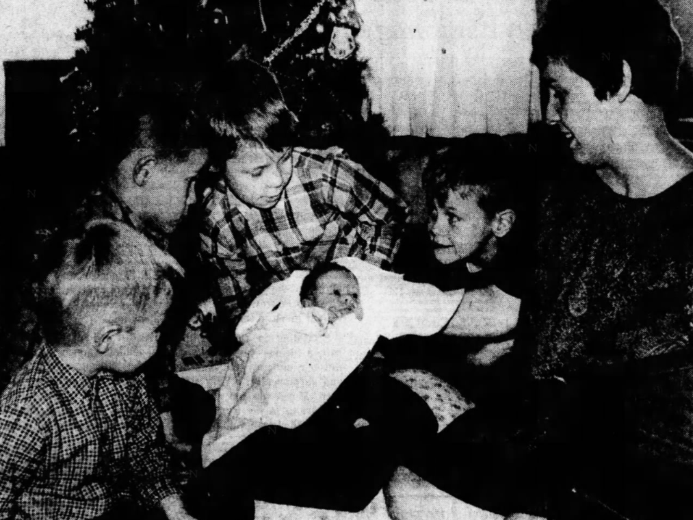The four sons of Mr. and Mrs. Duane Atcheson, who lived on Olinda Avenue in Des Moines, welcome home their 6-day-old sister, Lynn Marie, on Tuesday, Dec. 23, 1969. The Atcheson boys, from left, are Troy, 3; Robbie, 5; Rickey, 9; and Alan, 6.