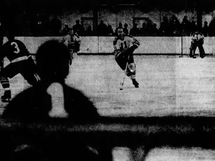 John Annable (11) makes himself right at home during an Oak Leafs' International Hockey League game Jan. 5, 1969, against Dayton at Ice Arena. Annable played for Leafs in 1968 before being traded to Toledo. The Jan. 5 game was his first in Des Moines since being traded back to the Leafs that same week. Des Moines lost, 3-2.