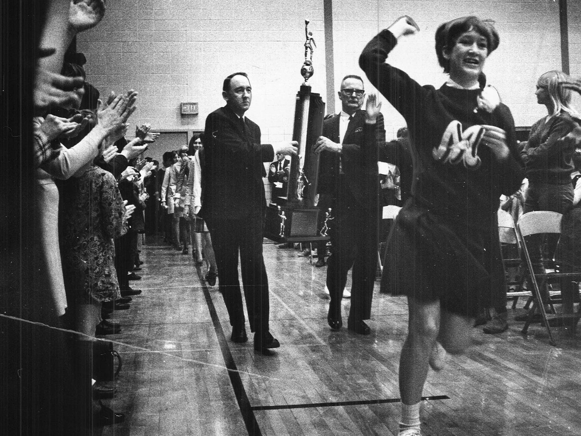 Close to 2,500 fans packed the Montezuma High School gymnasium in March 1969 to celebrate the school's first state girls' basketball tournament championship. The Saturday night title game that saw Montezuma beat Allison-Bristow 66-60 was followed by a caravan that picked up hundreds of cars on its way from Des Moines to Poweshiek County.