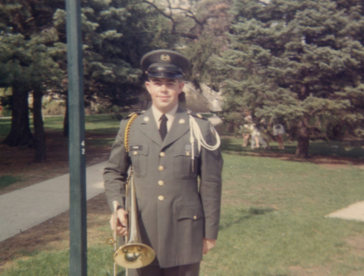 "Dean Brand is shown during the 1969 Veishea celebration as a member of the Iowa State University ROTC band. ""They didn't have sousaphones, so I had to play the trombone again,"" Brand wrote in he and wife Roddy's military scrapbook."