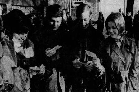 The first four of 400 Drake University students who waited through the night to buy tickets for the Drake basketball team's appearance in the NCAA Final Four in Kentucky smilingly walk away from the ticket office. From left: James Cooper of Washington, D.C.; Ralph Russo of Stamford, Connecticut; Frank Mackaman of Rolla, Missouri; and Debbie Knight of Boston.