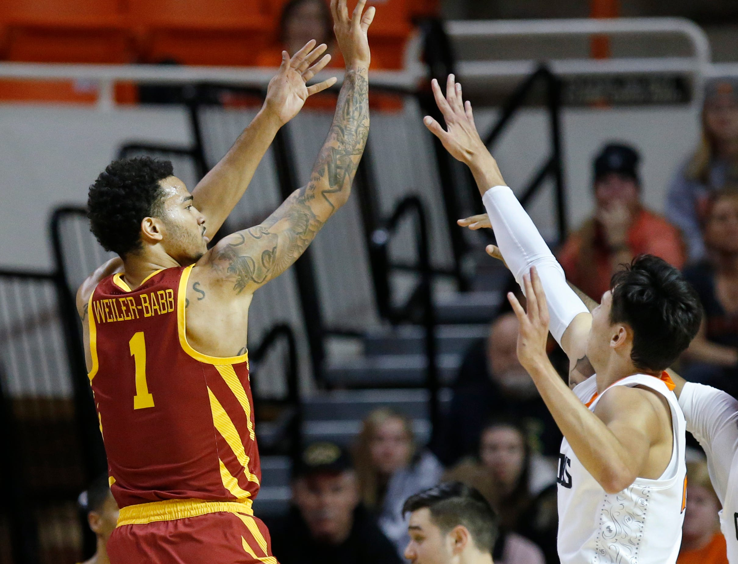 Iowa State guard Nick Weiler-Babb (1) shoots over Oklahoma State guard Lindy Waters III, right, during the first half of an NCAA college basketball game in Stillwater, Okla., Wednesday, Jan. 2, 2019. (AP Photo/Sue Ogrocki)