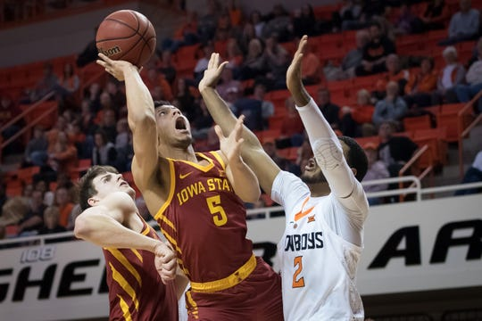 Jan 2, 2019; Stillwater, OK, USA; Iowa State Cyclones guard Lindell Wigginton (5) shoots the ball as Oklahoma State Cowboys forward Maurice Calloo (2) defends during the first half at Gallagher-Iba Arena.