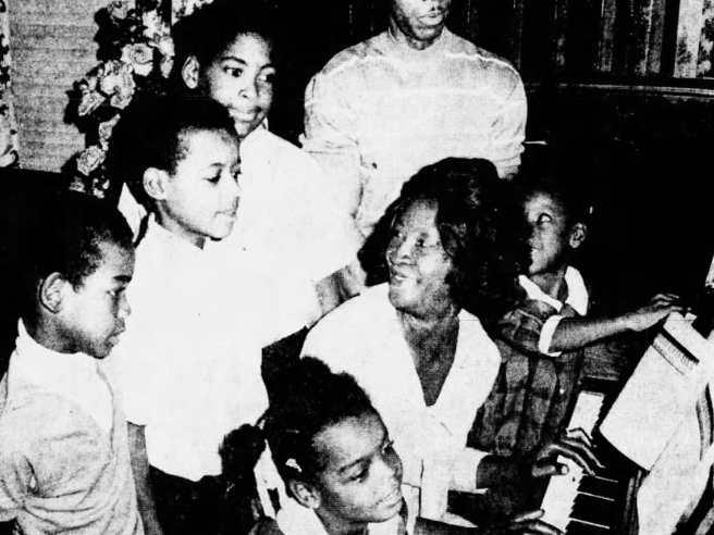 "William B. Walker and his wife Mary, of Des Moines, bought a piano ""for all of the children and they can take it from there,"" Mary said. ""We make up our songs and we sing a lot. We have a good time. The kids mostly want to stick around home."" Children are, clockwise from left, Valerie, 6; Harry, 7; Archie, 9; Calvin, 10, and at right on piano bench, Callie, 8."