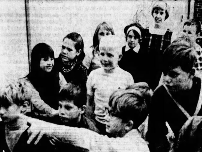All eyes turned to the television set on this November 1969 day at the Saydel elementary school for a broadcast of the Apollo 12 splashdown. Mrs. Penny Davidson, one of five Teacher Corpsmen who are working in experimental classrooms, is shown back right.