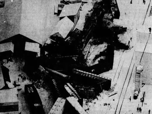 Milwaukee Road freight cars are strewn like jackstraws after a through freight plowed into the rear of a local freight New Year's morning (1969) near the center of Coon Rapids, killing the through freight's engineer and brakeman, both of Perry.