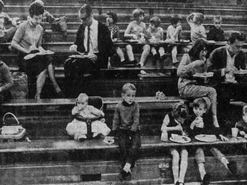 Bleachers in the gym make a handy perch for people and food during a picnic that ends the school year at Green Mountain in Marshall County, a tradition that was at least 40 years old in 1969.