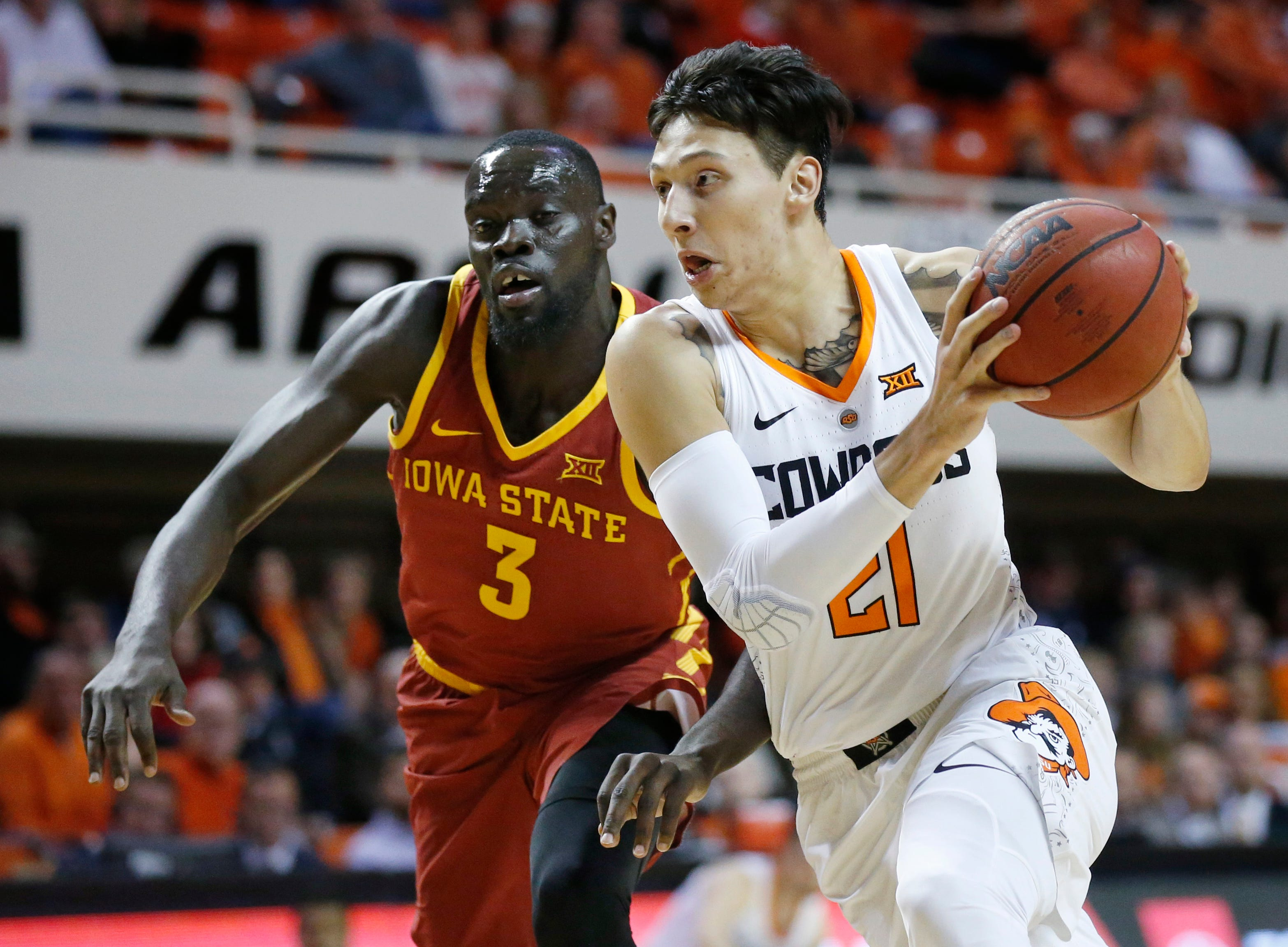 Oklahoma State guard Lindy Waters III (21) moves past Iowa State guard Marial Shayok (3) during the first half of an NCAA college basketball game in Stillwater, Okla., Wednesday, Jan. 2, 2019. (AP Photo/Sue Ogrocki)