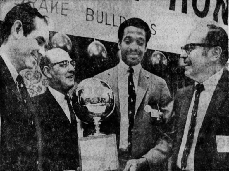 Drake University men's basketball player Willie McCarter receives the Clarkson Award March 23, 1969, as the most outstanding amateur basketball player in Iowa. From left: Iowa Gov. Robert Ray, George Clarkson, McCarter and Drake president Paul Sharp.