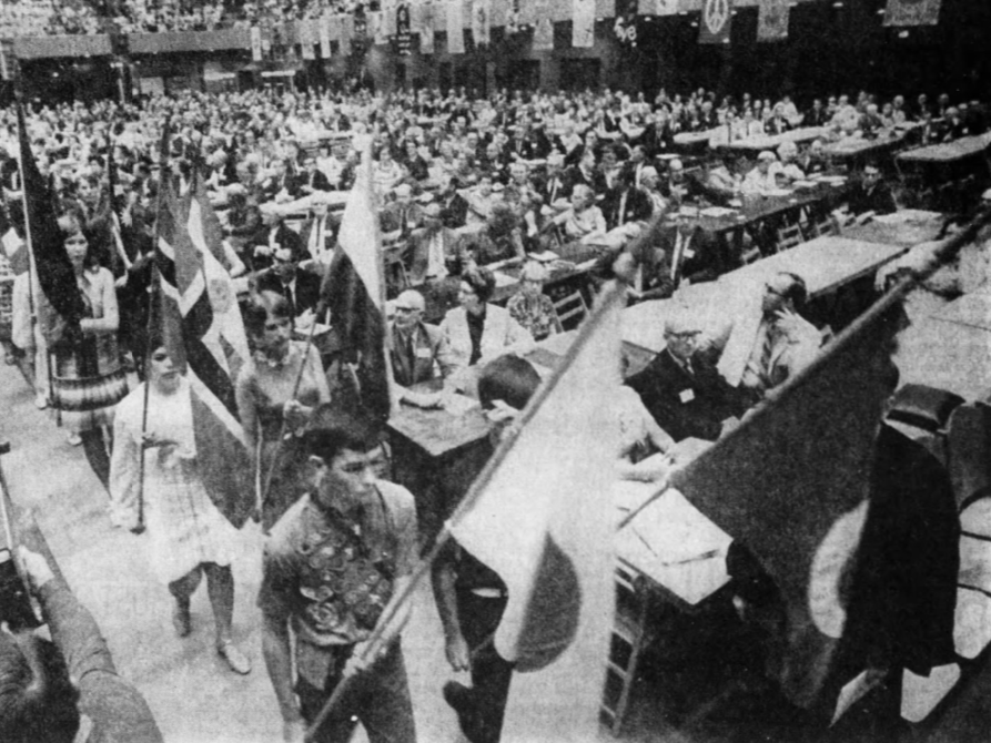 Flags from about 50 nations served by United Methodist missionaries were carried by Iowa youths during a June 1969 conference at Vetearns Memorial Auditorium in Des Moines.