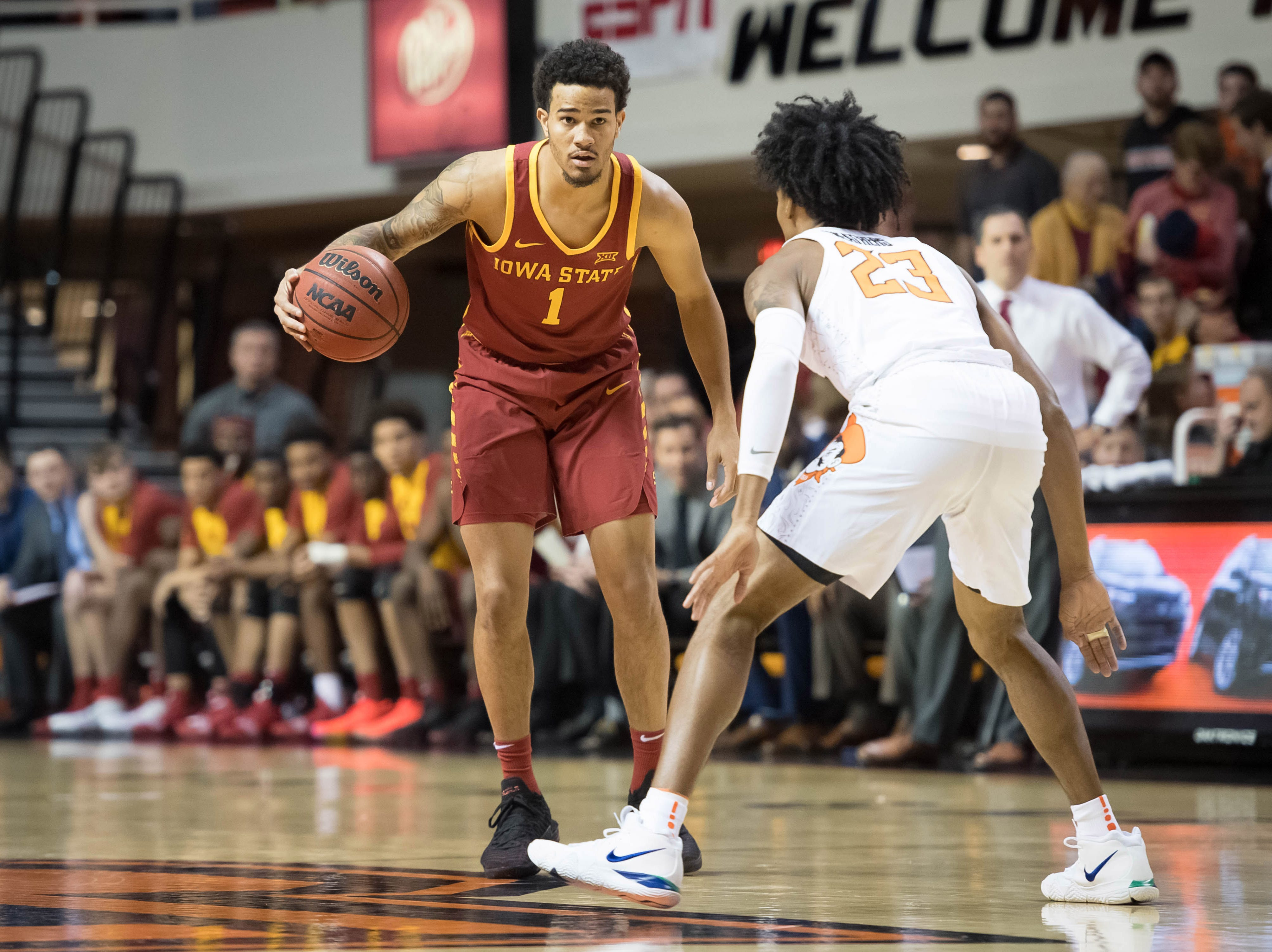 Jan 2, 2019; Stillwater, OK, USA; Iowa State Cyclones guard Nick Weiler-Babb (1) dribbles the ball as Oklahoma State Cowboys guard Michael Weathers (23) defends during the first half at Gallagher-Iba Arena.