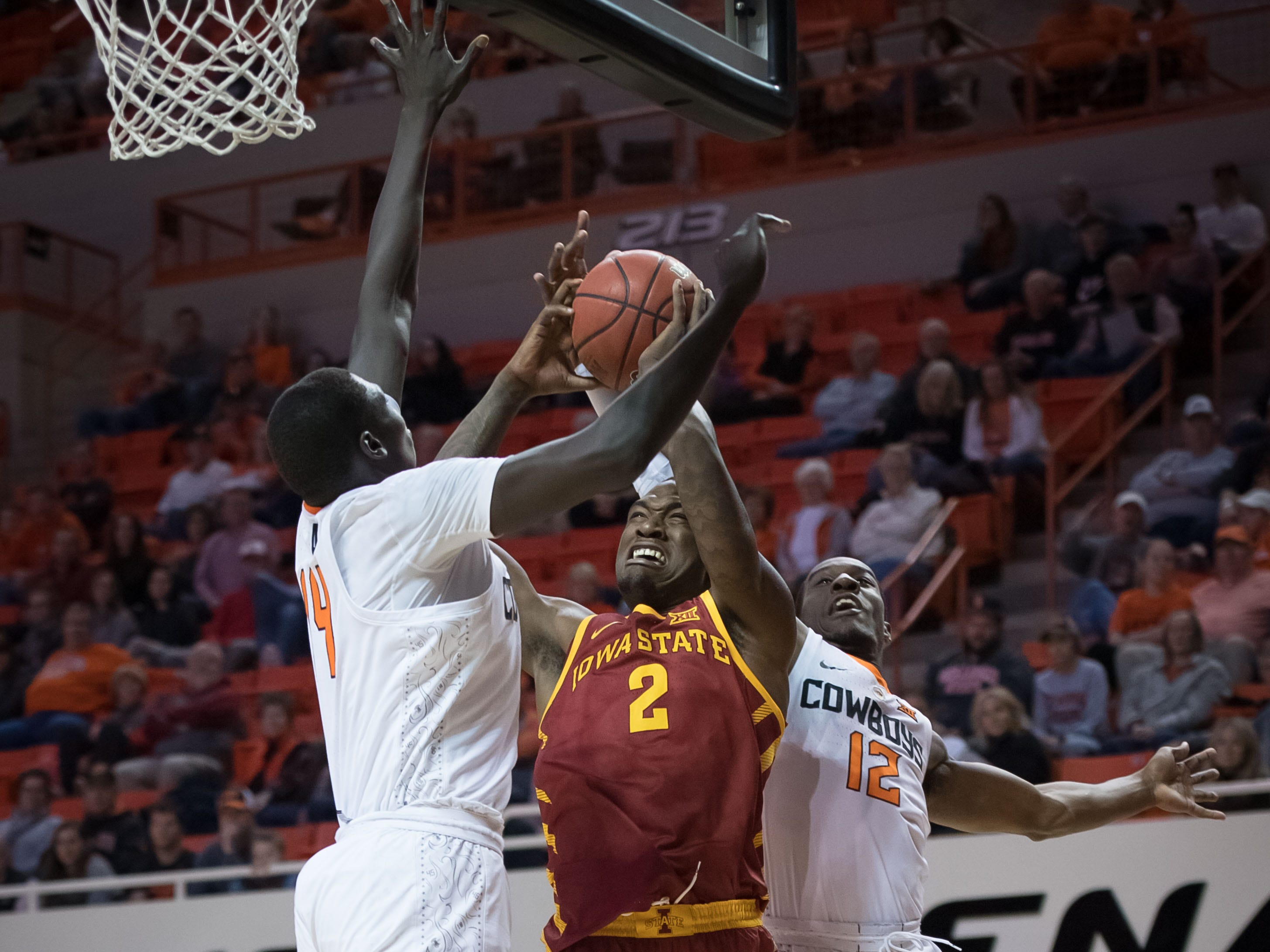Jan 2, 2019; Stillwater, OK, USA; Iowa State Cyclones forward Cameron Lard (2) shoots the ball as Oklahoma State Cowboys forward Yor Anei (14) defends during the first half at Gallagher-Iba Arena.