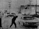 In what must have been one of the coldest jobs in Des Moines Jan. 2, 1969, a tow truck driver prepares to hook a line on a car stranded in the 1700 block of Maury Street, hubcap deep in freezing water. Four trucks and about a dozen cars were stuck in the frozen water used to fight an all-night fire at a nearby landfill dump at 17th and Harriett streets flowed onto Maury Street.