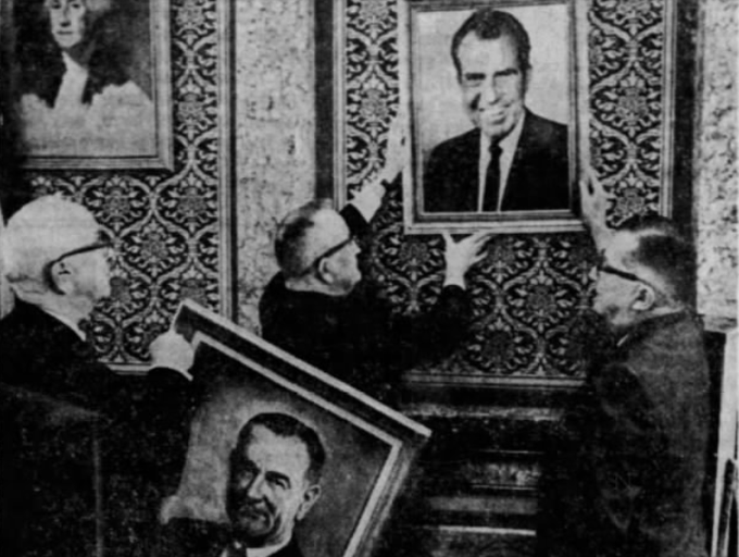 Shortly after Richard M. Nixon was sworn in as president Jan. 20, 1969, in Washington D.C. his portraits replaced photographs of Lyndon B. Johnson behind the presiding officers' chairs in the Iowa Legislature. In the House, Ralph Lancaster, left, of Des Moines, sergeant of arms, holds Johnson's picture while House Speaker William H. Harbor, of Henderson, and Chief Clerk William R. Kendrick, right, hung Nixon's portrait.