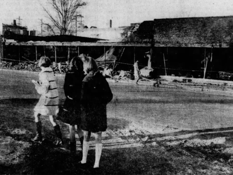 Three eighth-grade girls stop to view the scene of a fire that destroyed the Bruce & Carlson Furniture & Carpets store on Second Avenue in Des Moines. Officials suspected arson as the cause of the fire. From left, eighth-grade classmates Beverly Ancell, Debbie Manning and Cindy Mingo.